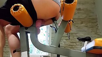 Captivating woman in the gym is delighting the horny guy