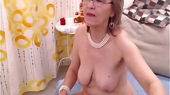 Blonde granny gets off with a dildo